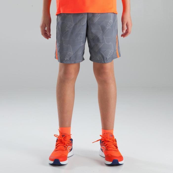 short baggy athlétisme enfant gris clair rouge fluo