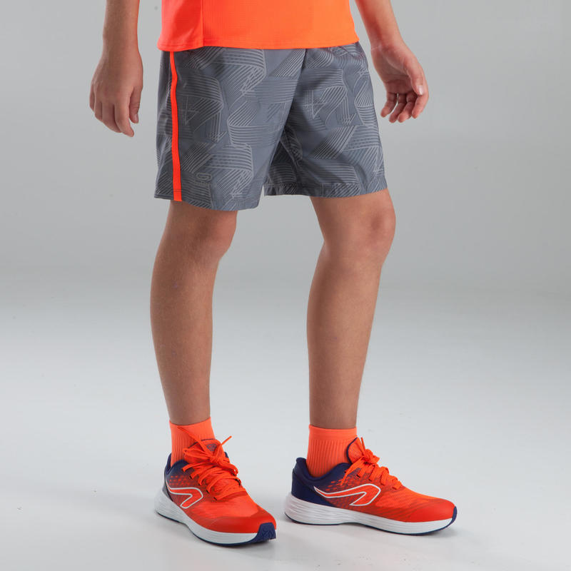 Children's baggy athletics shorts light grey neon red