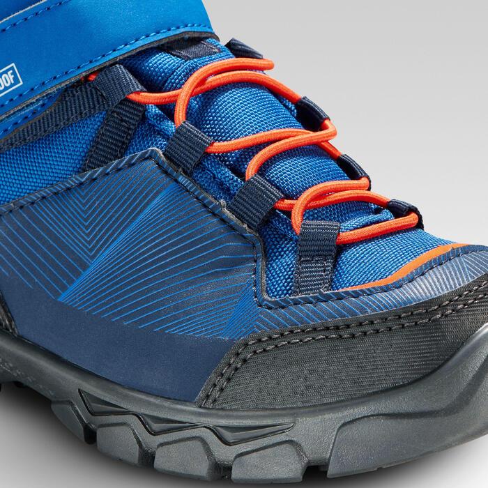 Hoge wandelschoenen met klittenband voor kinderen MH120 mid blauw 28 tot 34