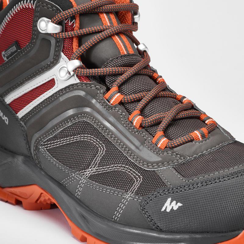 Men's mountain walking waterproof shoes MH100 Mid – Grey Orange