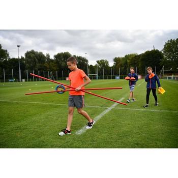 Children's baggy athletics shorts light grey neon red