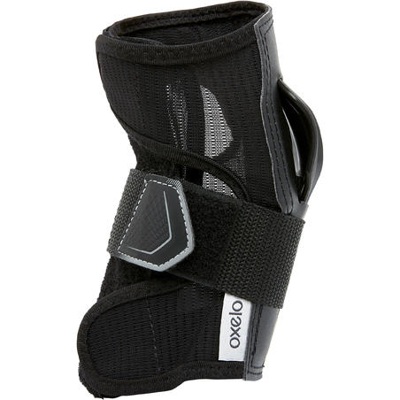 Muñequeras patines, skateboard adulto FIT500 negro gris