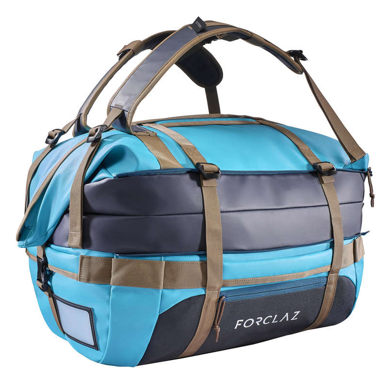 TRANSPORT BAGS, DUFFLE HIKING/TREK Trekking - Voyage 40 - 60L Extendable Holdall - Blue FORCLAZ - Trekking