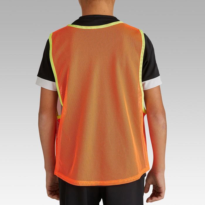 Kinderhesje voor teamsporten fluo-oranje