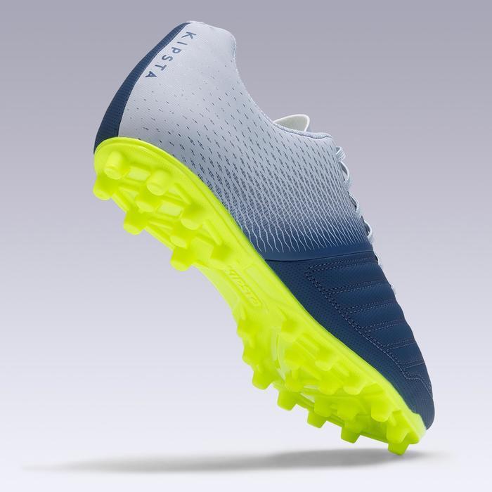 Chaussure de football adulte terrains secs Agility 140 FG adulte grise