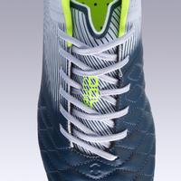 Tenis de fútbol para terrenos secos para adulto Agility 700 piel FG gris