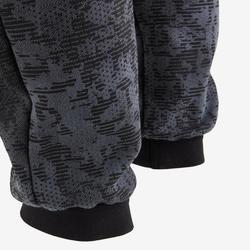 Warme joggingbroek voor gym jongens 100 regular fit zwart/print