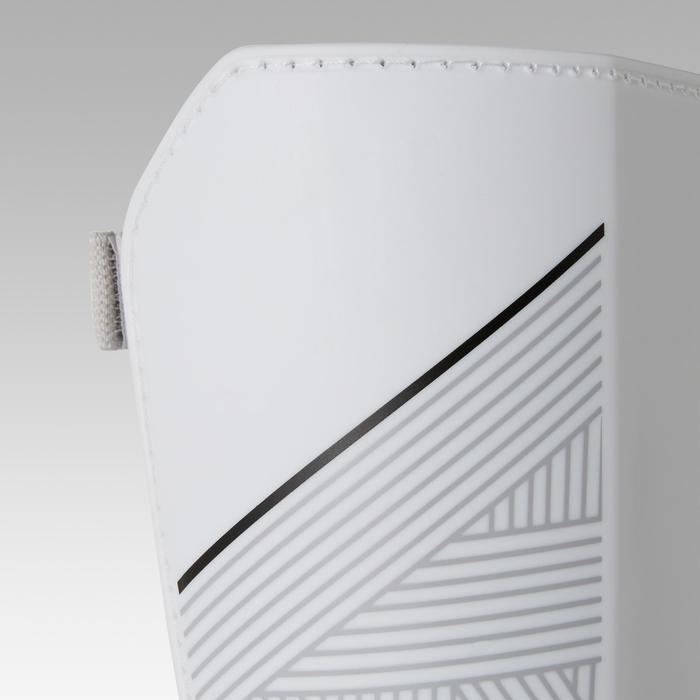 Espinilleras de fútbol con tobillera desmontable adulto F140 blanco