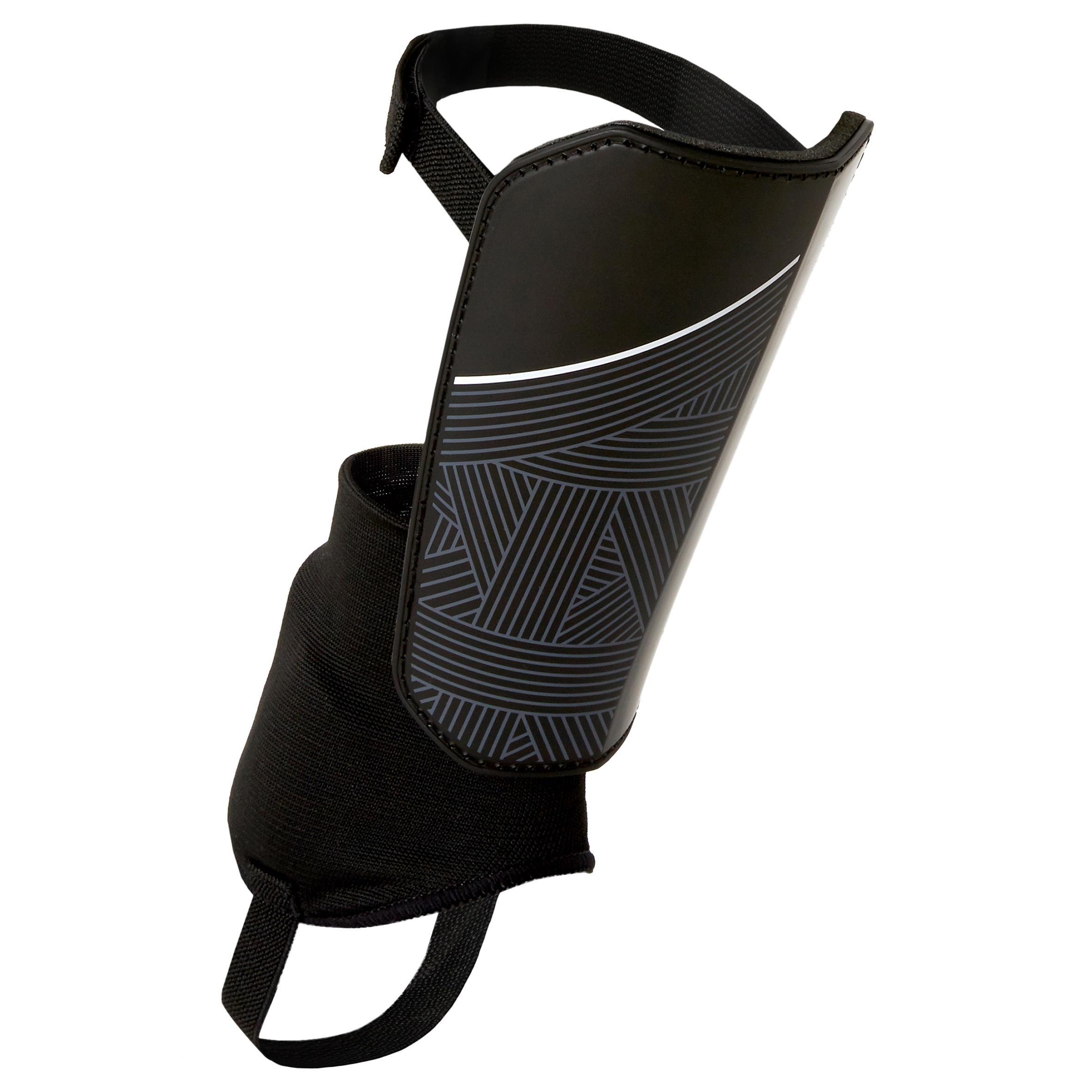 Espinillera de fútbol júnior F140 (tobillera desmontable) negro