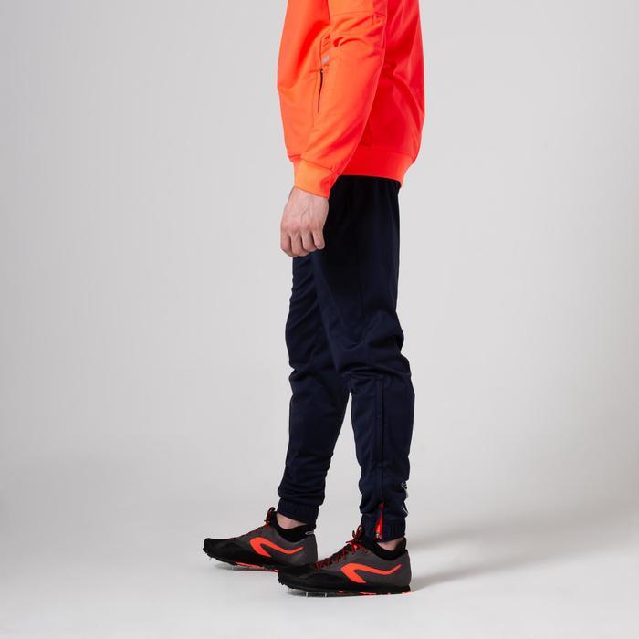 男款田徑短褲藍色與橘色