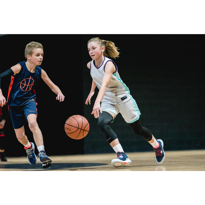 Wendetrikot Basketball T500 Kinder violett