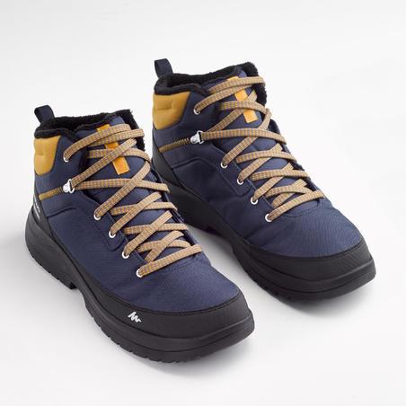 bottes de randonnée neige homme SH100 chaude mi-hauteur bleues.