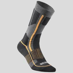 Warme wandelsokken volwassenen SH520 X-Warm mid zwart/oranje