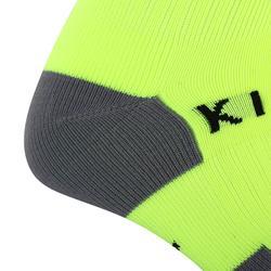 Chaussette de football rayée enfant F500 jaune fluo