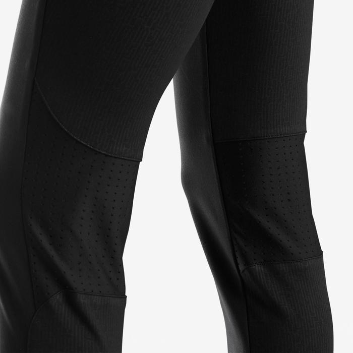 Warme en ademende sportbroek voor gym jongens S900 slim fit zwart/rode accenten