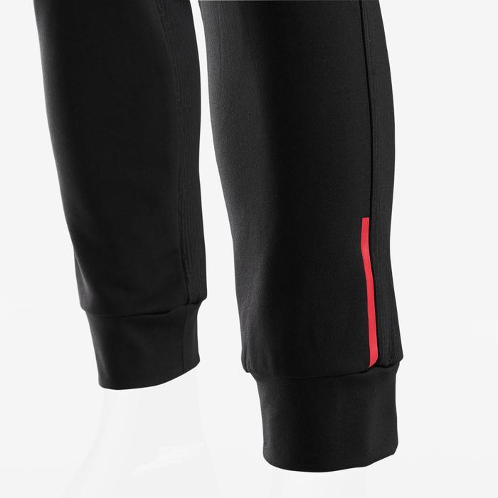 Warme en ademende gymbroek voor jongens S900 slim fit zwart met rode accenten