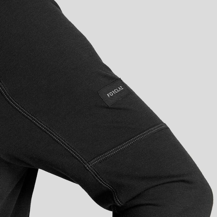 男款登山健行美麗諾羊毛長袖拉鍊T恤TREK500-黑色