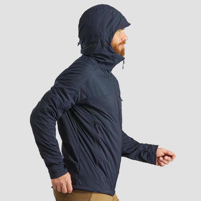 Warme winddichte softshell jas voor bergtrekking heren Trek 900 Windwarm blauw