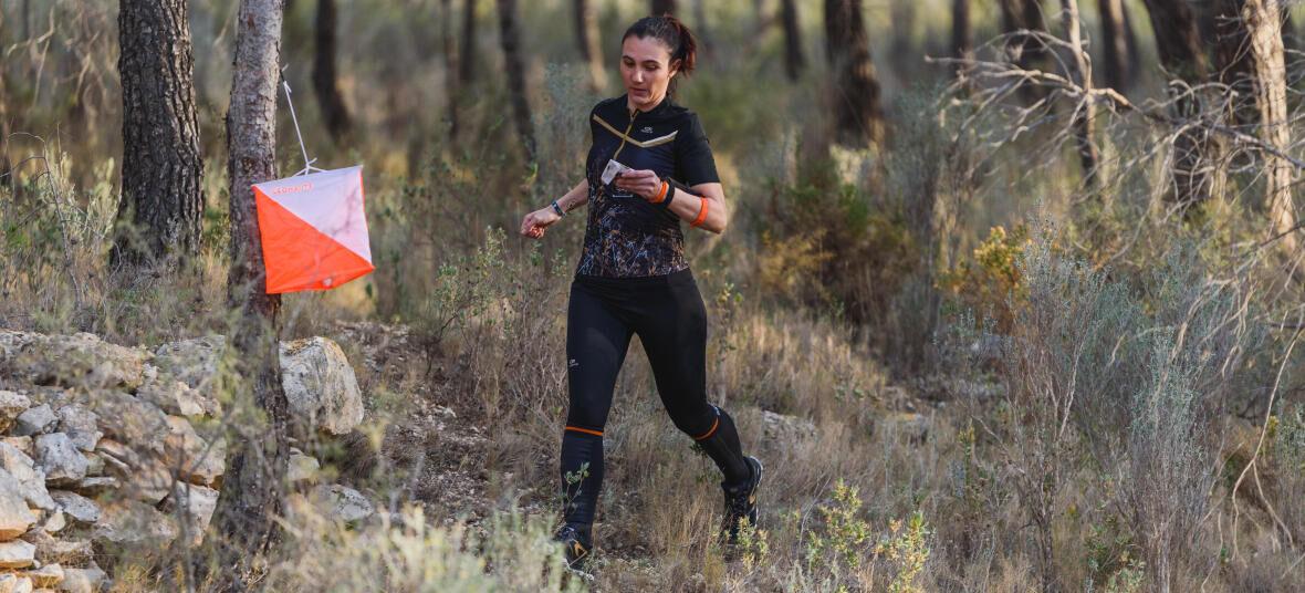 Orienteering woman punchs control
