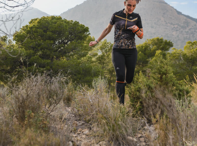 Woman runs in south forest