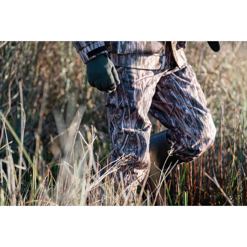 933361c0a0525 500 waterproof hunting trousers with wetlands camo | Solognac