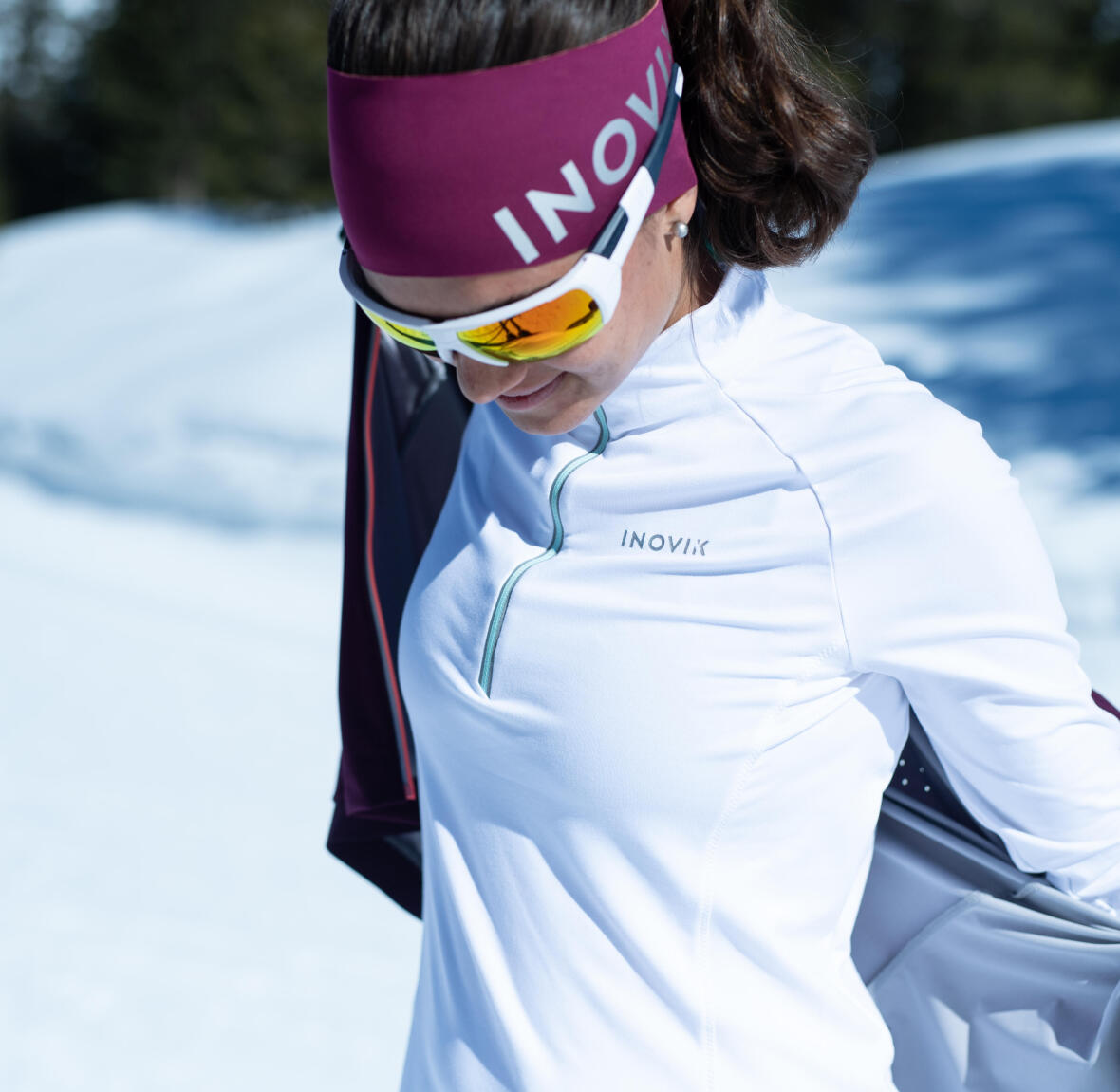 woman take off her cross-country skiing jacket