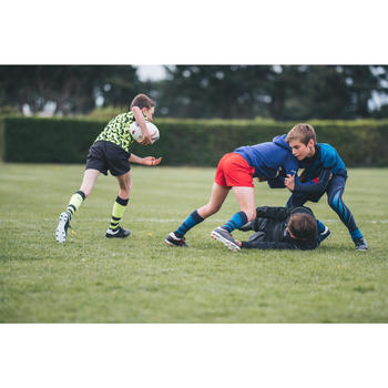 Short rugby R100 niños rojo
