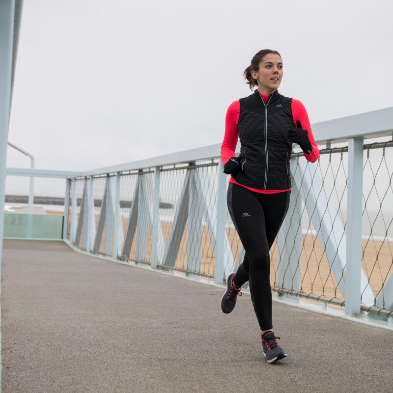 Woman running in multilayers
