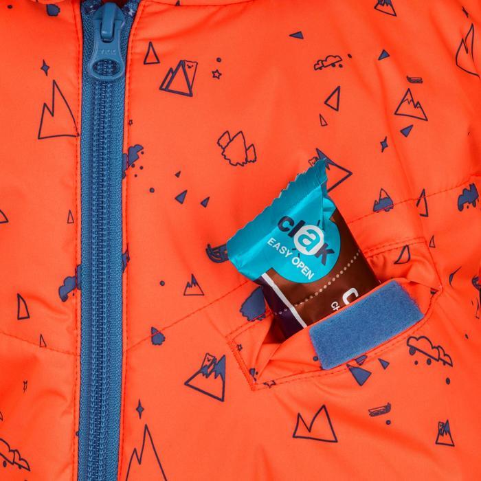 Combinaison de ski / luge bébé warm imprimée en orange et bleue