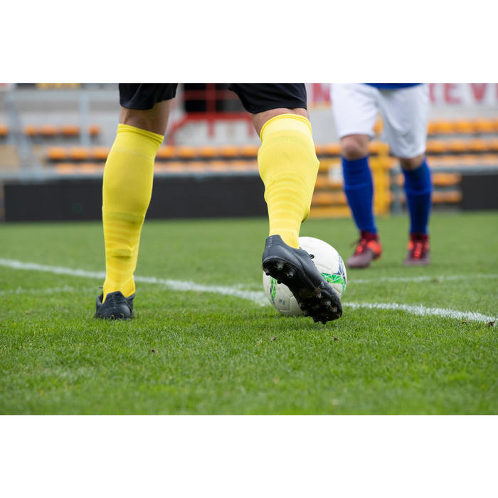 Botas de Fútbol adulto Kipsta Agility 700 piel FG negro y gris
