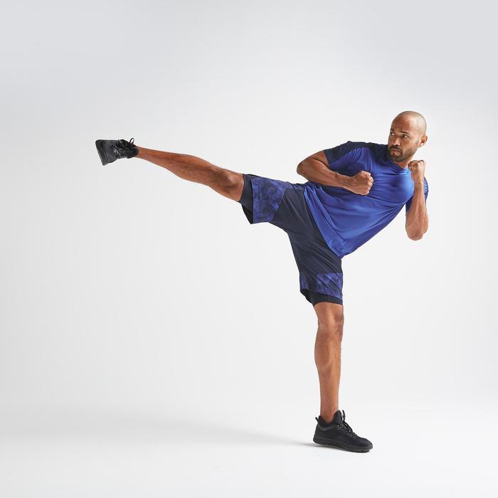 Short cardio fitness homme FTS 520 2 en 1 navy AOP camo.