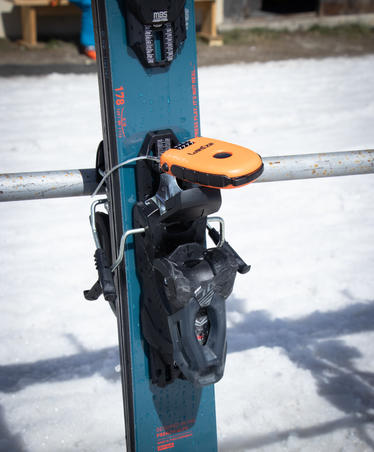 Anti-theft lock for a snowboard or pair of skis