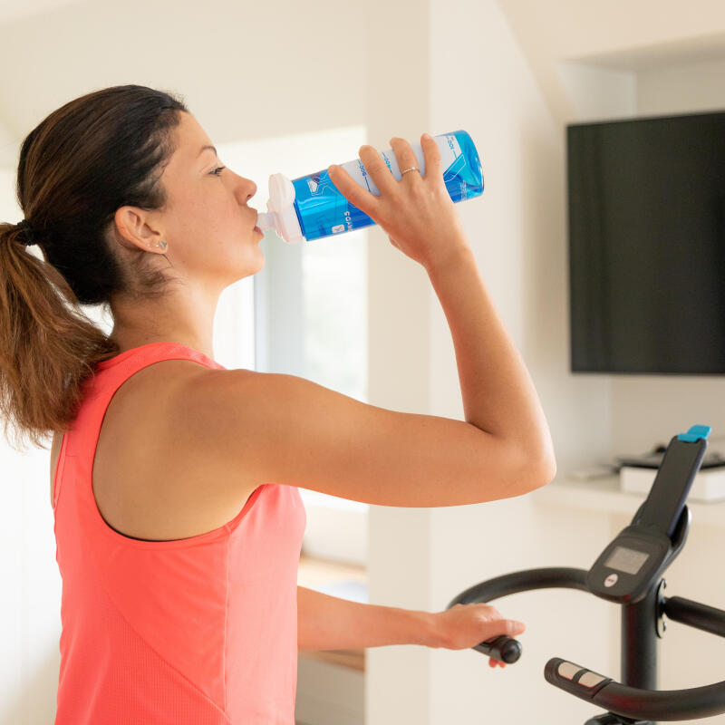 Woman drinking water during a workout session