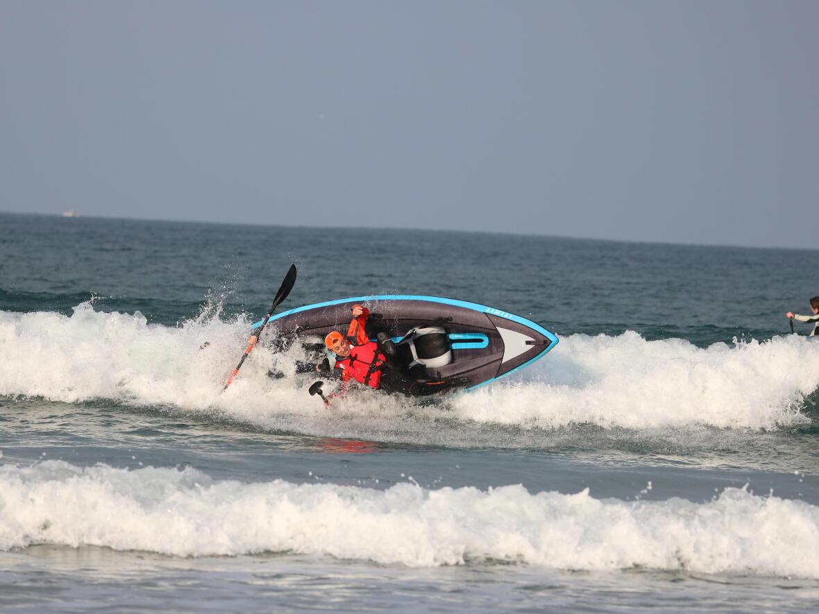 wave sea kayak surfing