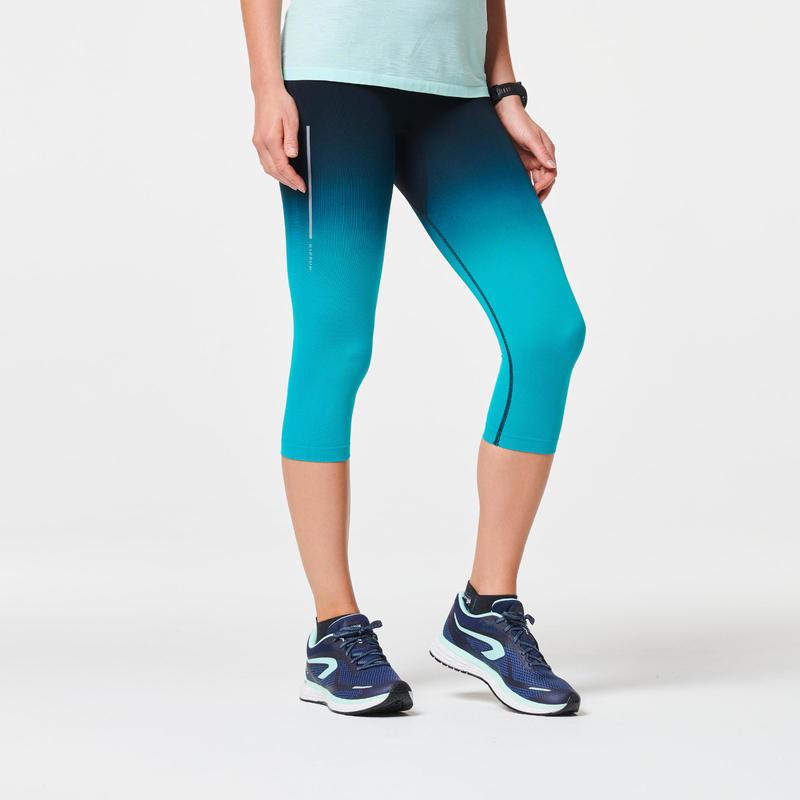 กางเกงขาส่วนผู้หญิงระบายอากาศได้ดีสำหรับใส่วิ่งรุ่น KIPRUN CARE (สีดำ/เขียว)