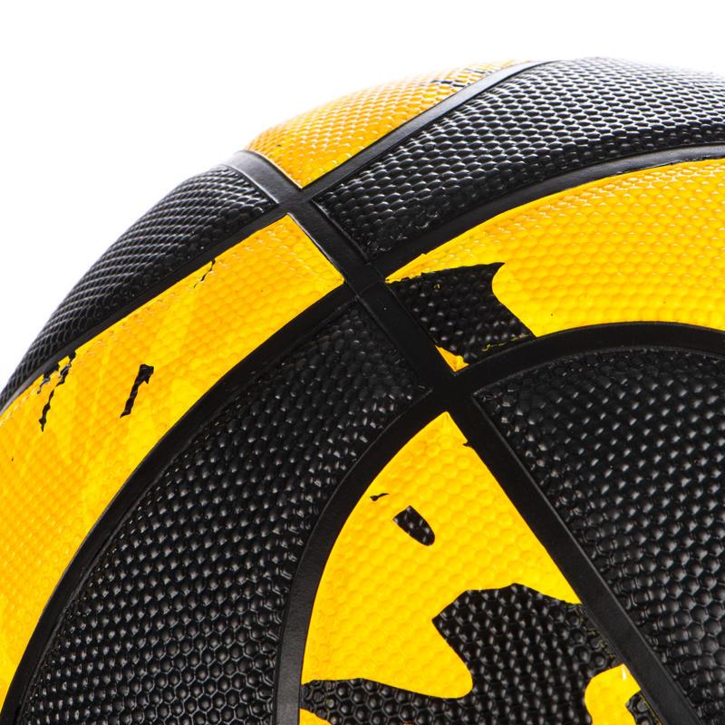 Ballon de basket homme R300 T7 jaune noir à partir de 13 ans pour débuter.