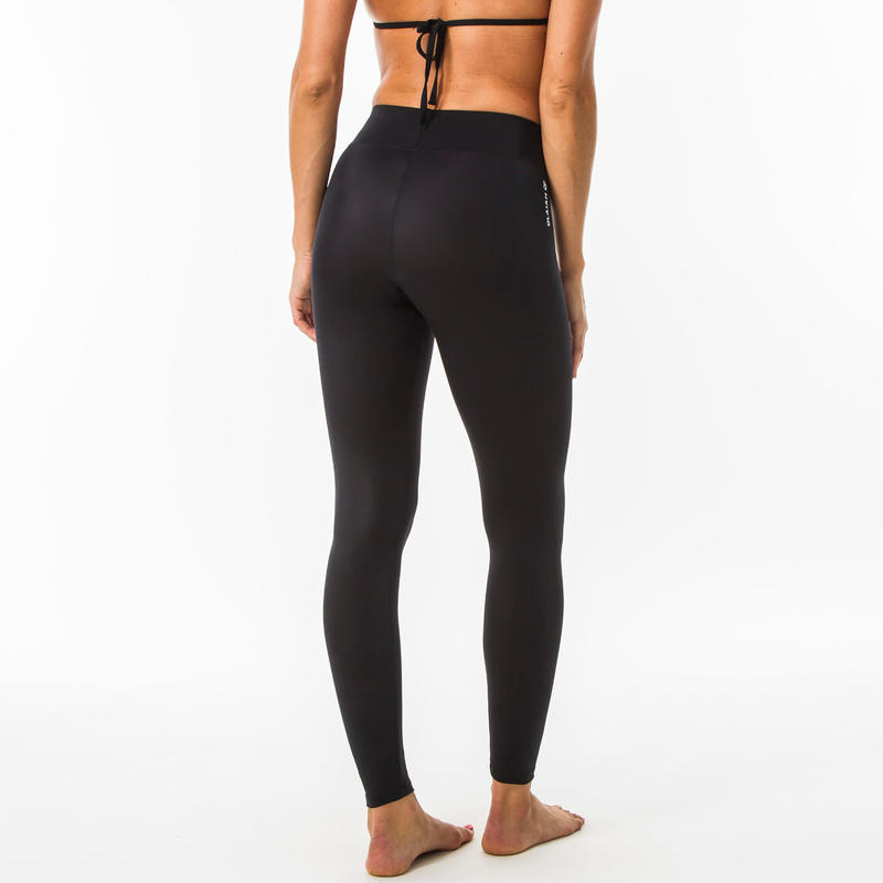 กางเกงเลกกิ้งป้องกันรังสียูวีสำหรับผู้หญิงใส่โต้คลื่นรุ่น 100 (สีดำ)