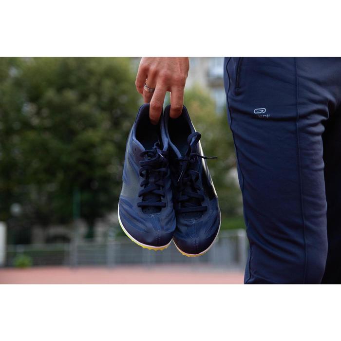 Atletiekschoenen met spikes halve afstand AT Mid blauw zwart en geel
