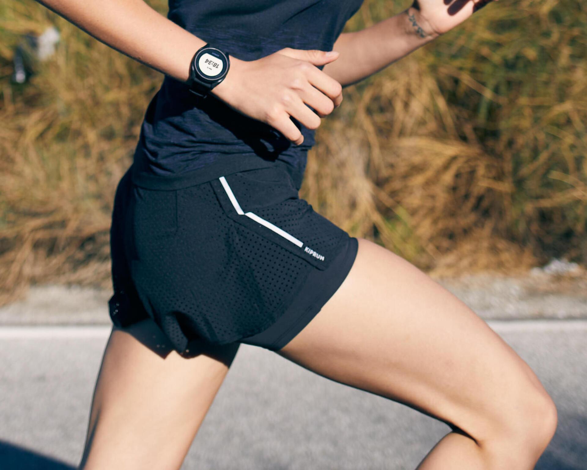 KIPRUN WOMEN'S 2-IN-1 RUNNING SHORTS WITH BUILT-IN TIGHT SHORTS - BLACK