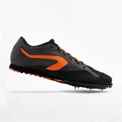 Veldloopschoenen met spikes zwart en oranje