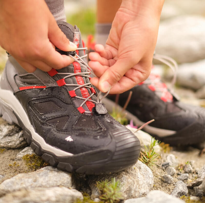 How do I correctly fasten and tie up my hiking shoes?