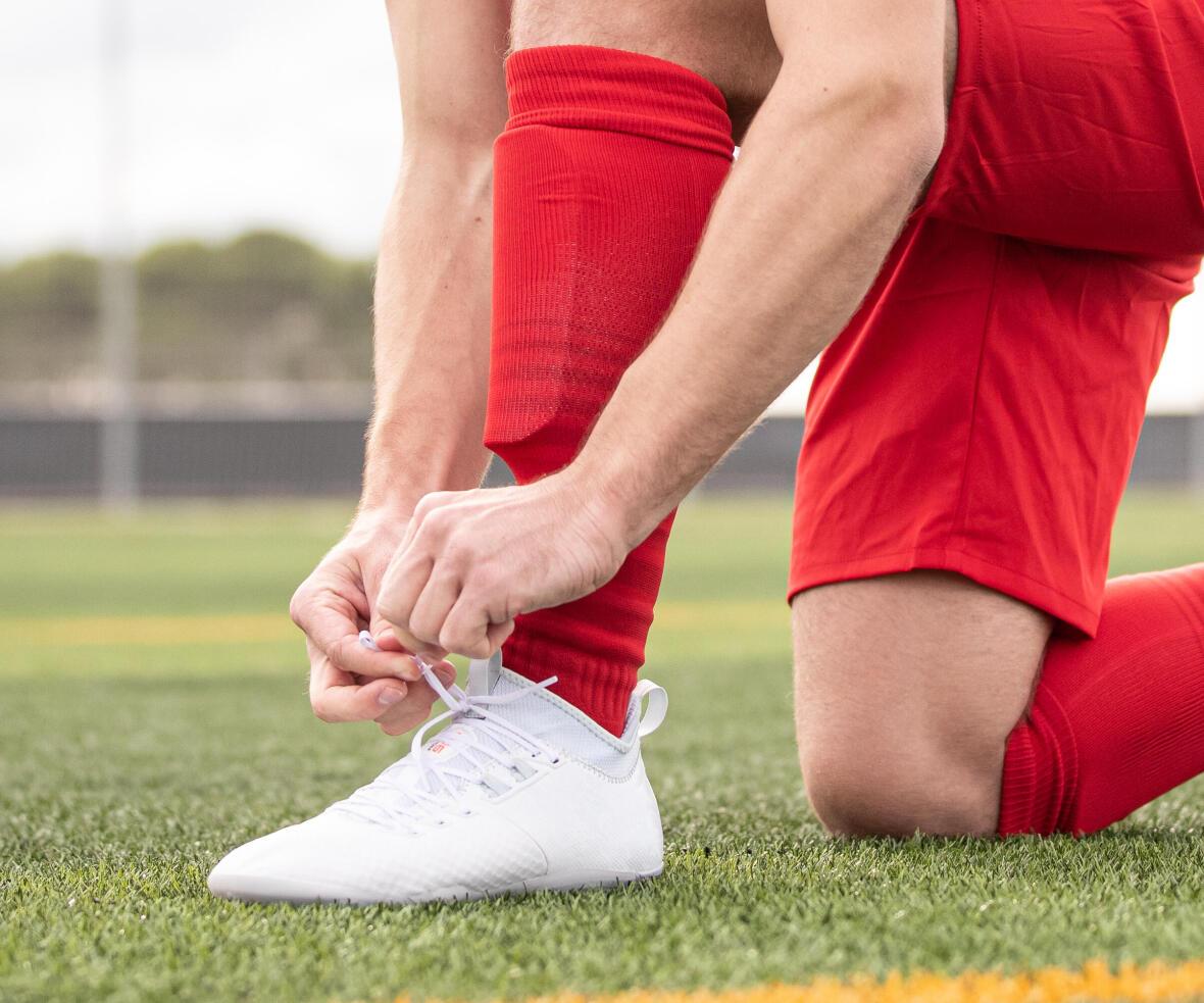 chaussures adaptées à la surface du terrain de soccer