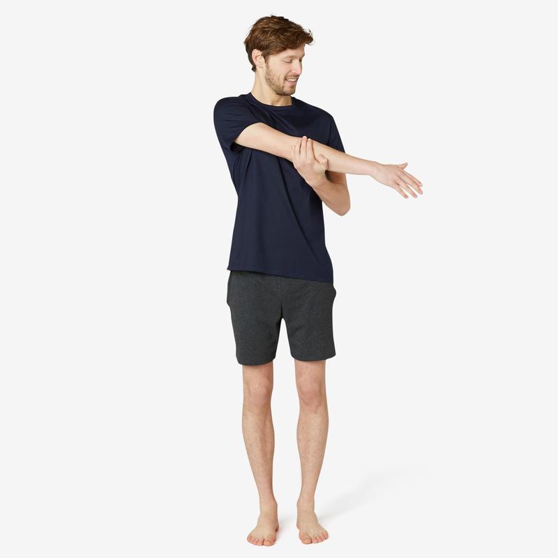 เสื้อยืดผู้ชายทรงมาตรฐานสำหรับกายบริหารทั่วไปและพิลาทิสรุ่น 100 (สีกรมท่า)