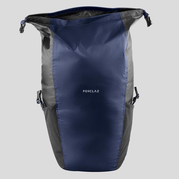 Compact and waterproof 20 litre trekking travel backpack TRAVEL 100 - NAVY BLUE