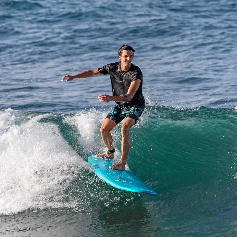 กางเกงชายหาดขาสั้นสำหรับโต้คลื่นรุ่น 100 (สีมินต์ลายต้นปาล์ม)