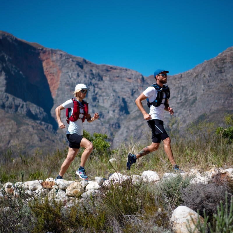 a man and a woman running in hot weather on the mountain