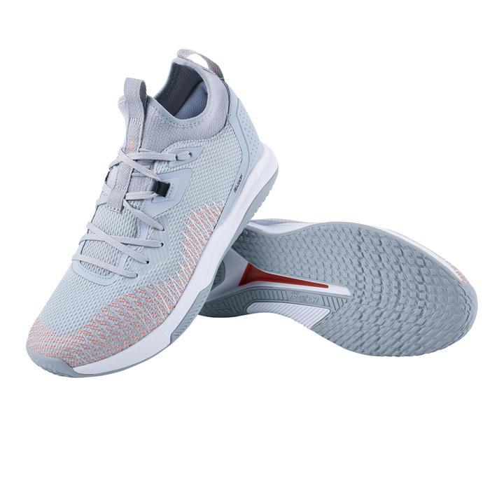 女款中階低筒籃球鞋Fast 500-白橘配色