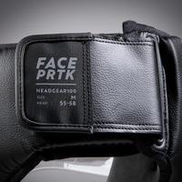 Casque 100 adulte noir avec protection faciale intégrée.