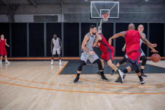 men playing basketball game