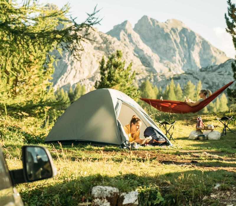 2women camping and enjoying the quiet of nature